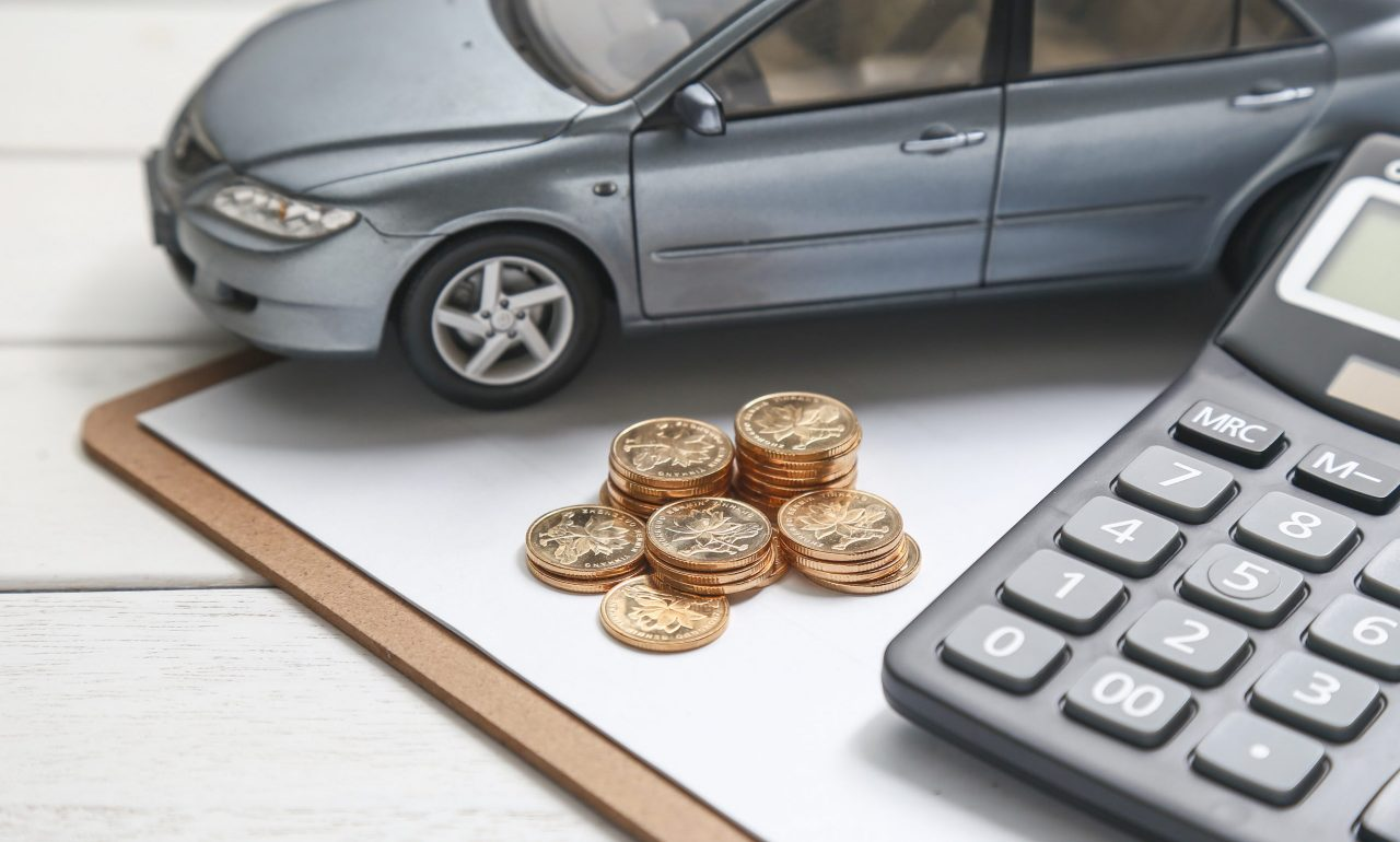 car-model-calculator-coins-white-table-scaled.jpg